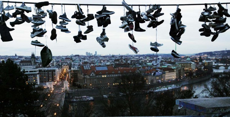 Shoes hang on a power line at Letna park overlooking Prague early January 2, 2013. Czech teenagers, who skateboard at the park, throw their damaged and unwanted shoes over the wire at the city's main skating hangout. (Petr Josek/Reuters)