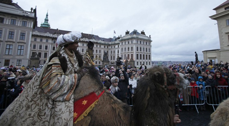 A man dressed as King Balthazar greets spectators while riding a camel during the Three Kings procession at Hradcanske Square as part of a re-enactment of the Nativity scene, in Prague. (David W Cerny/Reuters)