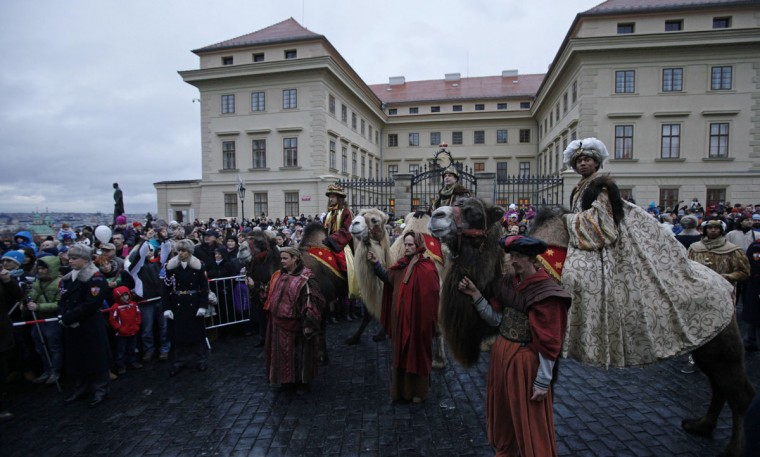 Men dressed as the Three Kings sit on camels during the Three Kings procession at Hradcanske Square as part of a re-enactment of the Nativity scene, in Prague. (David W Cerny/Reuters)
