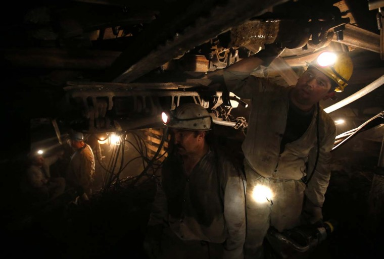Miners work in Hungary's last remaining deep-cast coal mine at Markushegy, 70 km west of Budapest, January 23, 2013. (Laszlo Balogh/Reuters)