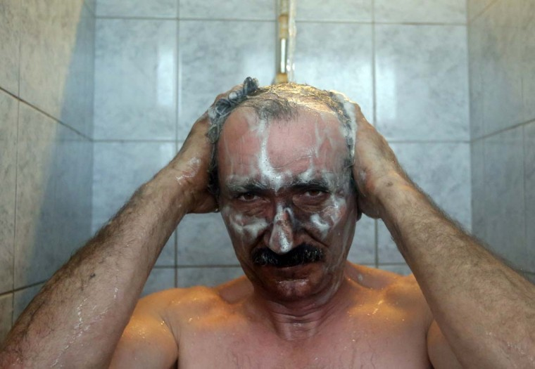A miner takes a shower after his shift in Hungary's last remaining deep-cast coal mine at Markushegy, 70 km west of Budapest, January 23, 2013. (Laszlo Balogh/Reuters)
