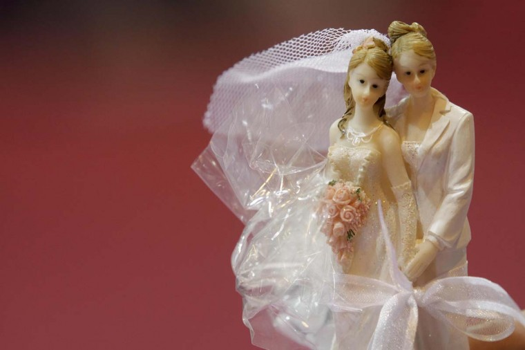 Plastic figurines depicting a female same-sex married couple are displayed during a wedding show in Strasbourg January 6, 2013. Picture taken January 6, 2013. (Jean-Marc Loos/Reuters)