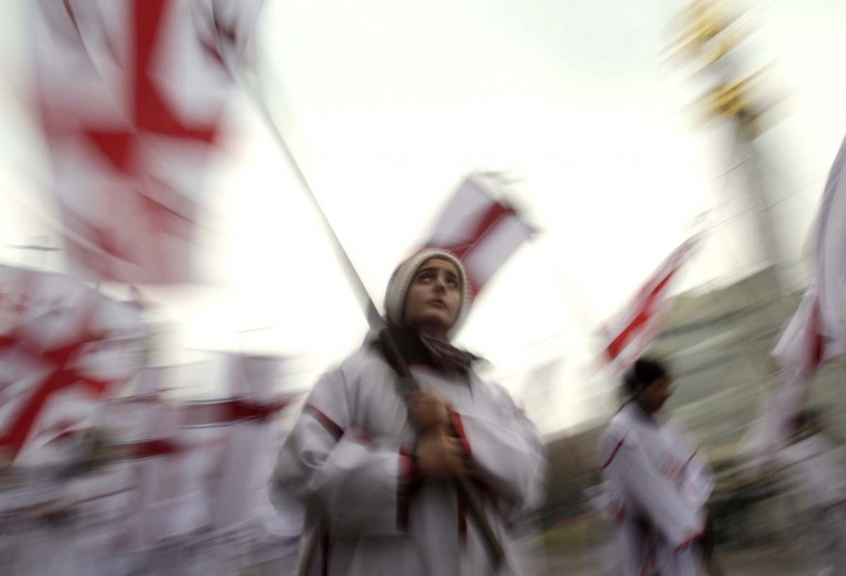 """Participants march with national flags during """"Alilo"""", a religious procession, to celebrate the Orthodox Christmas in Tbilisi January 7, 2013. Believers celebrate Christmas on January 7, according to the Julian calendar used by the country's Orthodox church. (David Mdzinarishvili/Reuters)"""