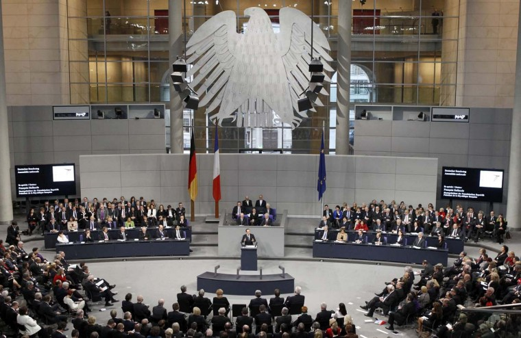 French President Francois Hollande addresses a joint meeting of the German lower house of parliament, Bundestag and French National Assembly at the Reichstag in Berlin January 22, 2013, during a day of celebrations marking the 50th Anniversary of the Elysee Treaty that sealed a reconciliation between the former adversaries. (Fabrizio Bensch/Reuters)
