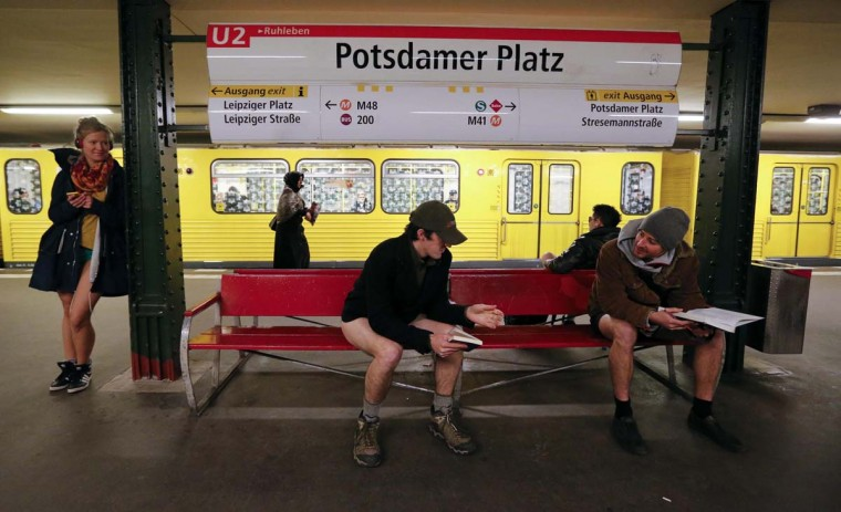 "People without their pants wait for a subway train at Potsdamer Square subway station during the ""No Pants Subway Ride"" in Berlin January 13, 2013. The event, organised by Improv Everywhere, involves participants who strip down to their underwear as they go about their normal routine. (Fabrizio Bensch/Reuters)"