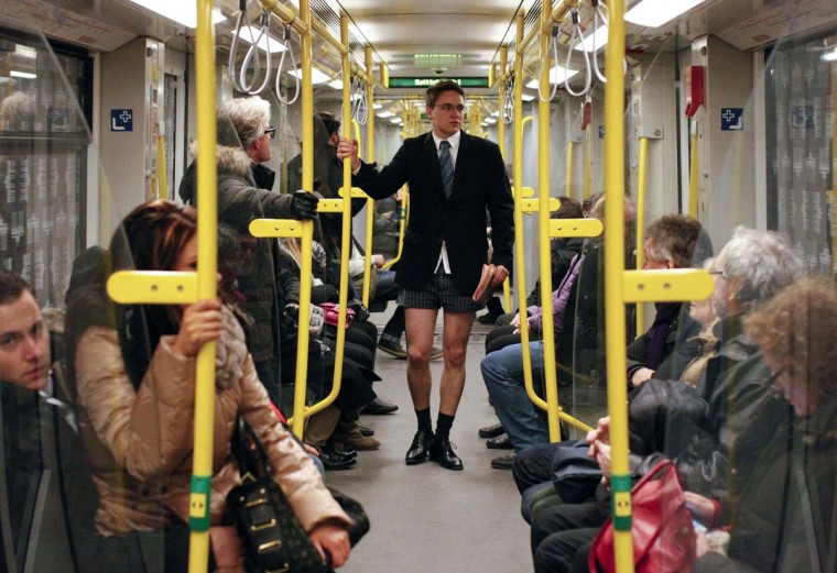 "Passengers look at a man without his pants on the subway during the ""No Pants Subway Ride"" in Berlin January 13, 2013. The event, organised by Improv Everywhere, involves participants who strip down to their underwear as they go about their normal routine. (Fabrizio Bensch/Reuters)"