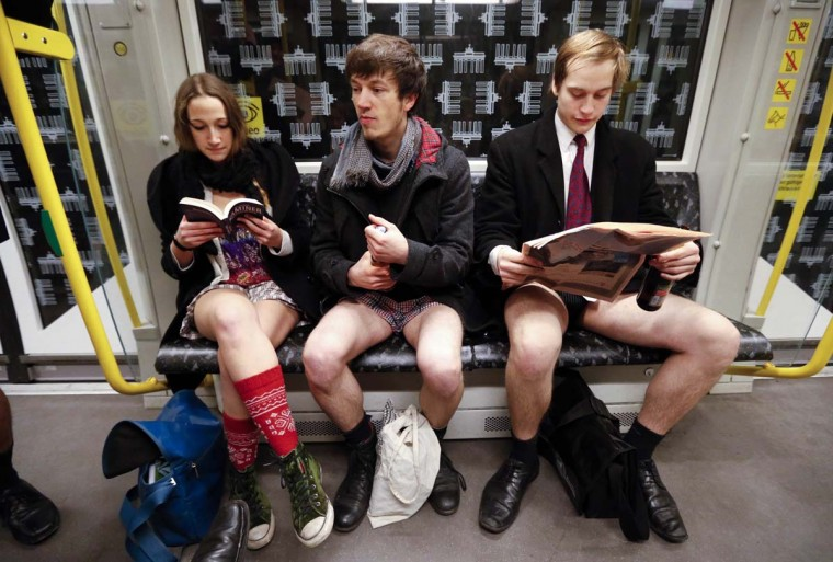 "People without their pants take part in the ""No Pants Subway Ride"" in Berlin January 13, 2013. The event, organised by Improv Everywhere, involves participants who strip down to their underwear as they go about their normal routine. (Fabrizio Bensch/Reuters)"