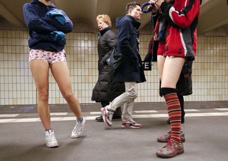 "Commuters watch people without their pants at a subway station during the ""No Pants Subway Ride"" in Berlin January 13, 2013. The event, organised by Improv Everywhere, involves participants who strip down to their underwear as they go about their normal routine. (Fabrizio Bensch/Reuters)"