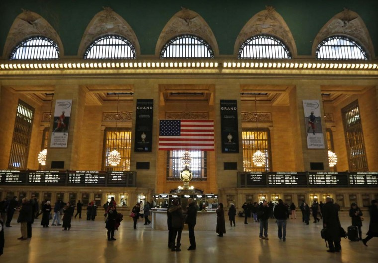 Commuters move through the grand hall of Grand Central Terminal in New York, January 25, 2013. It plays host hundreds of thousands of visitors each day, had an extensive facelift in the 1990s and was nearly demolished about 55 years ago, but Grand Central Terminal survived and is celebrating its 100th anniversary. (Brendan McDermid/Reuters)