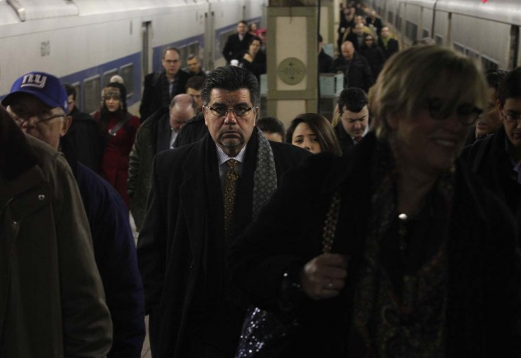 Morning commuters get off trains at Grand Central Terminal in New York, January 25, 2013. (Brendan McDermid/Reuters)