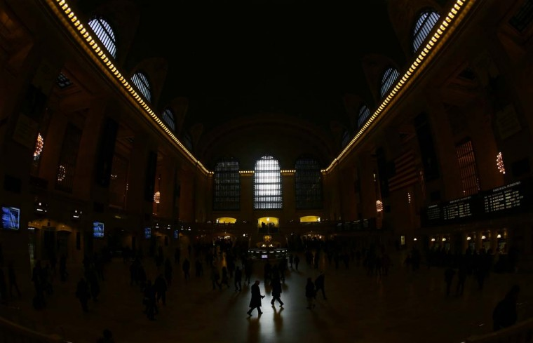 Commuters walk through the grand hall of Grand Central Terminal during the morning rush in New York, January 25, 2013. (Brendan McDermid/Reuters)