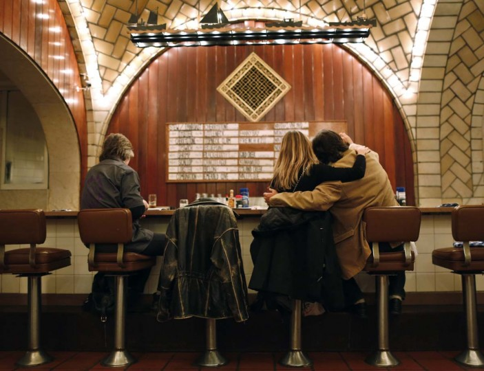 Customers sit at the counter of the Oyster bar in the lower level of Grand Central Terminal in New York, January 29, 2013. (Brendan McDermid/Reuters)