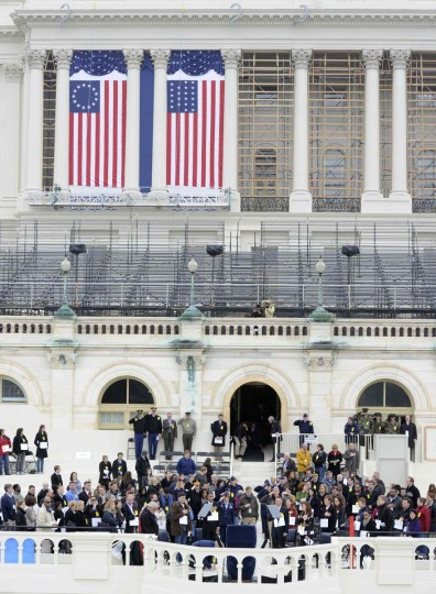 Actors portraying U.S. President Barack and his official party join other stand-ins for a dress rehearsal of the swearing-in ceremony at the US Capitol, Washington DC, January 13, 2013. The official inauguration and swearing-in is January 21, 2013. (Mike Theiler/Reuters)