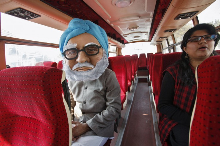 A man wears a costume depicting Indian Prime Minister Manmohan Singh as he sits inside a bus during an awareness campaign in New Delhi. The campaign was launched by Avaaz on Thursday to create awareness among the masses to stop violence against women, a media release from the non-profit organization said. (Mansi Thapliyal/Reuters)