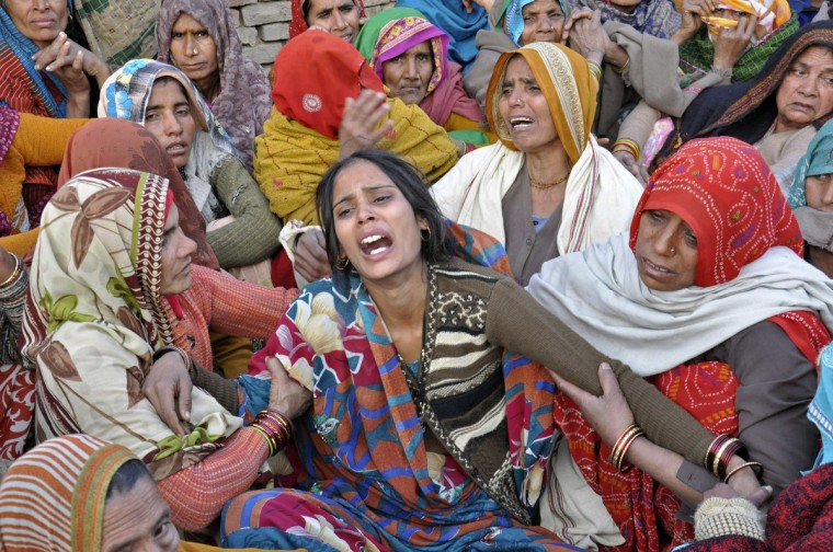 Dharamvati (C), wife of Indian soldier Hemraj Singh, weeps outside her house before Singh's body was brought for cremation in the Mathura district of the northern Indian state of Uttar Pradesh. India denounced Pakistan on Wednesday over a firefight in the disputed territory of Kashmir in which two Indian soldiers were killed, but the nuclear-armed rivals both appeared determined to prevent the clash escalating into a full diplomatic crisis. (Reuters)