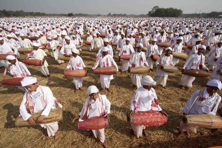 A total of 14,833 Assamese people on Sunday attempted to enter the Guinness Book of World Record by playing the drums for 15 minutes non-stop at a field in the Titabar town in the northeastern Indian state of Assam January 6, 2013. (Utpal Baruah/Reuters)