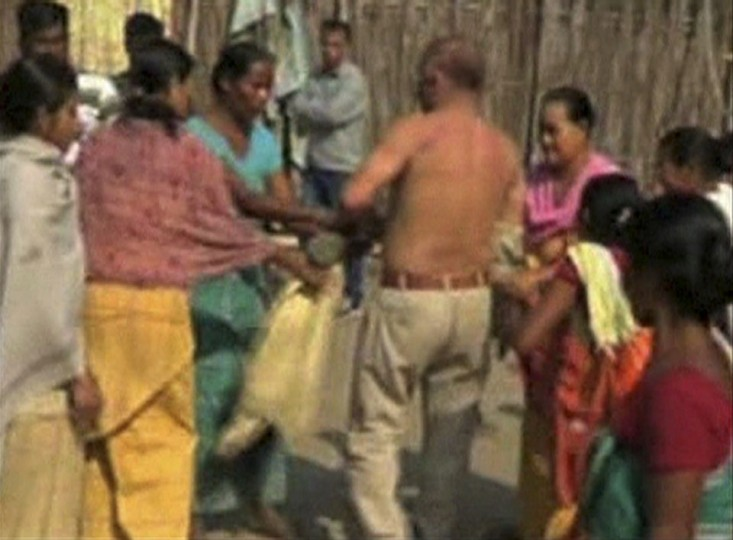Local women strip and beat Bikrmasingh Brahma, a prominent leader of India's ruling Congress party, for allegedly raping a mother of two in the Chirang district of the northeastern state of Assam, in this still image taken from video January 3, 2013. Neighbours alerted by screams raised by the woman rushed to her aid and were said to have thrashed the politician after apparently catching him. He had been handed over to local police. (ANI via Reuters TV)