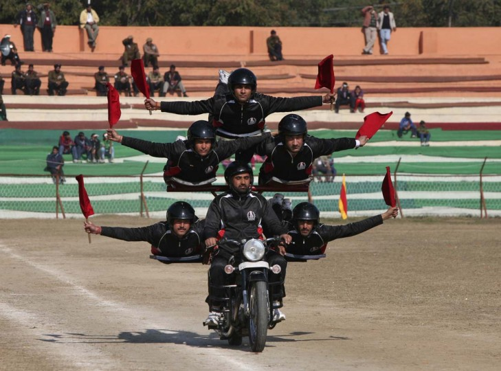 Indian policemen perform a stunt on a motorcycle during the Republic Day parade in Jammu January 26, 2013. India celebrated its 64th Republic Day on Saturday. (Mukesh Gupta/Reuters)