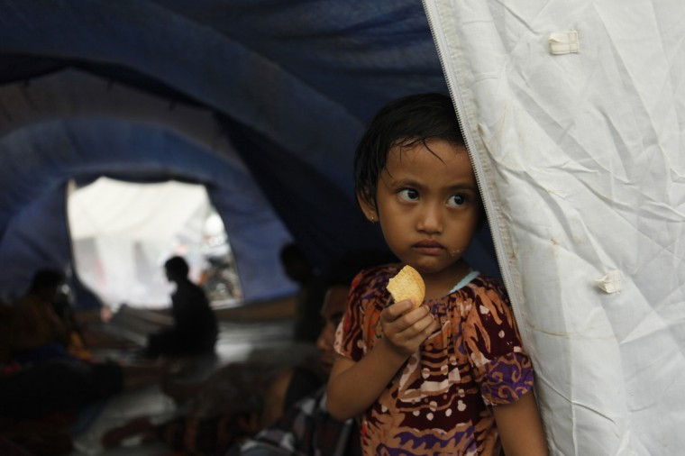 A child looks on at a temporary shelter beside Jakarta-Merak toll road as the flood hits her house at Undar-Andir village near Serang, in Indonesia's Banten province. Floodwaters inundated at least 1,850 houses across 33 districts in Banten province since Tuesday, killing three residents, local media reported. (Beawiharta/Reuters photo)