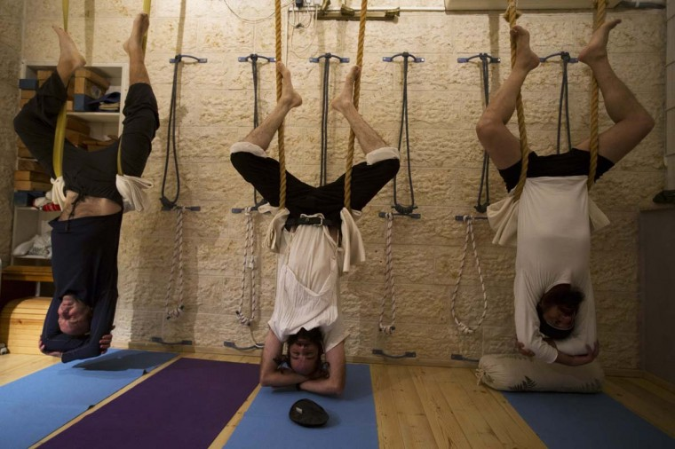 Ultra-Orthodox Jewish men take part in a yoga class at a studio in Ramat Beit Shemesh, about 12 miles from Jerusalem January 1, 2013. Almost a dozen devout Jewish men meet weekly at the studio, the only one of its kind in a neighbourhood where tensions have flared in the past between religious and secular Jews. The studio offers gender separated classes in accordance with the religious beliefs against mixing of the sexes in public. (Ronen Zvulun/Reuters)