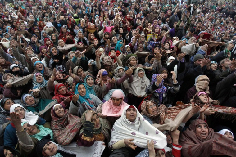 Kashmiri Muslims raise their arms upon seeing a relic of Prophet Mohammad being displayed to devotees during the festival of Eid-e-Milad at Hazratbal shrine in Srinagar. Thousands of Kashmiri Muslims on Friday thronged to the shrine of Hazratbal, which houses a relic believed to be a hair from the beard of Prophet Mohammad, to celebrate Eid-e-Milad or the Prophet's birth anniversary. (Danish Ismail/Reuters)