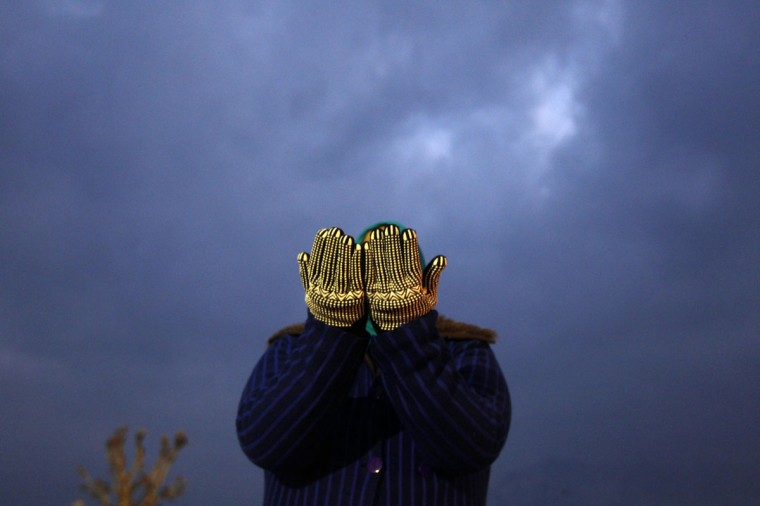 A Kashmiri Muslim woman prays on a cold winter morning during the festival of Eid-e-Milad at Hazratbal shrine in Srinagar. Thousands of Kashmiri Muslims on Friday thronged to the shrine of Hazratbal, which houses a relic believed to be a hair from the beard of Prophet Mohammad, to celebrate Eid-e-Milad or the Prophet's birth anniversary. (Danish Ismail/Reuters)
