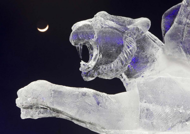 "The crescent moon is seen behind an ice sculpture during ice and snow sculptures festival at the ""Eight Lakes"" Park-Resort outside Almaty January 14, 2013. (Shamil Zhumatov/Reuters)"