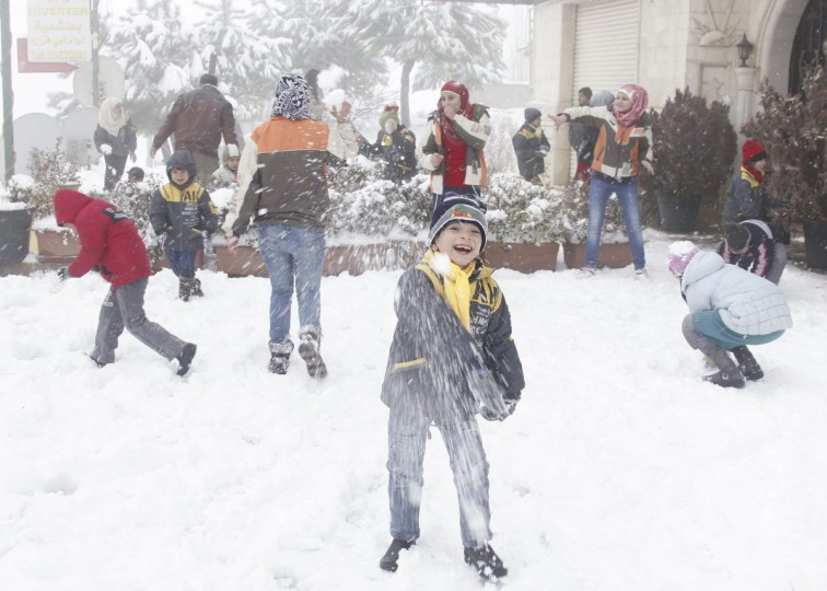 Children play with snow in Aley area, eastern Lebanon. (Mohamed Azakir /Reuters)