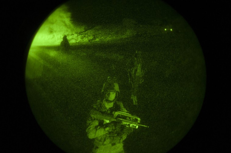 French troops, seen through a night vision device, advance towards Timbuktu in this undated picture provided by the French Military audiovisual service (ECPAD). French and Malian troops retook control of Timbuktu, a UNESCO World Heritage site, after Islamist rebel occupiers fled the ancient Sahara trading town and torched several buildings, including a library holding priceless manuscripts. (Arnaud Roine//Reuters)
