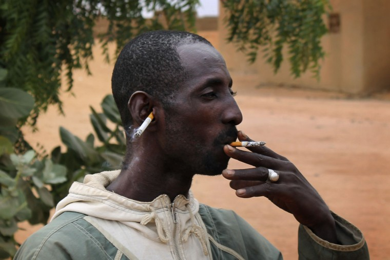 A Malian man smokes a cigarette with another lit cigarette placed in his ear to celebrate the arrival of French and Malian troops in Gao. Radical Islamist group MUJAO, which held Gao until French and Malian forces chased them out of the town four days ago, had banned smoking cigarettes according to their interpretation of the sharia Islamic law. (Adama Diarra/Reuters)