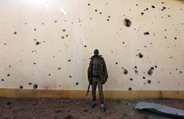A Malian soldier stands near a wall with bullet holes in the recently liberated town of Konna January 26, 2013. (Eric Gaillard/Reuters)