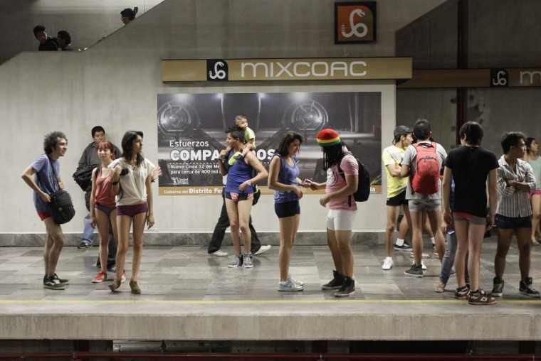 "Participants of ""No Pants Subway Ride"" wait for the train in Mexico City January 13, 2013. The event is organized by Flashmob Mexico where participants have to strip down to their underwear as they go about their normal routine, said organizers. (Henry Romero/Reuters)"