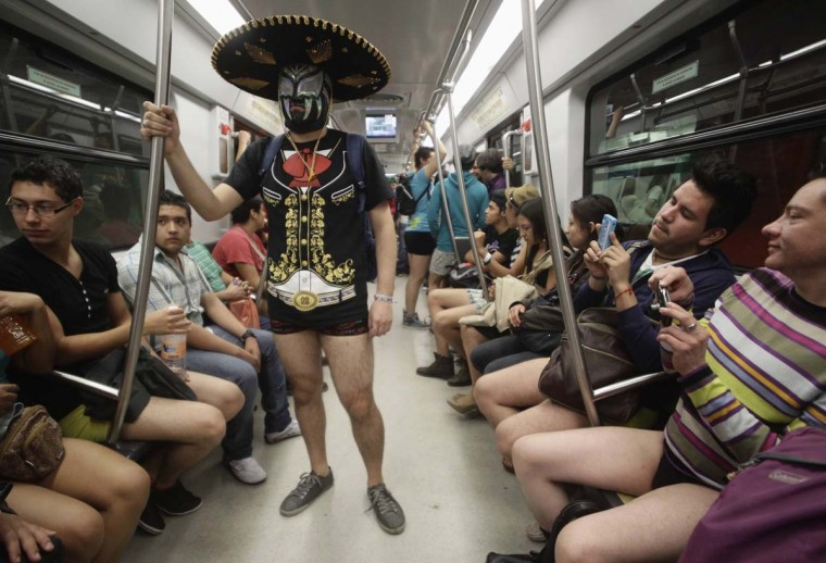 "A participant of ""No Pants Subway Ride""stands in a subway train in Mexico City January 13, 2013. The event is organized by Flashmob Mexico where participants have to strip down to their underwear as they go about their normal routine, said organizers. (Henry Romero/Reuters)"