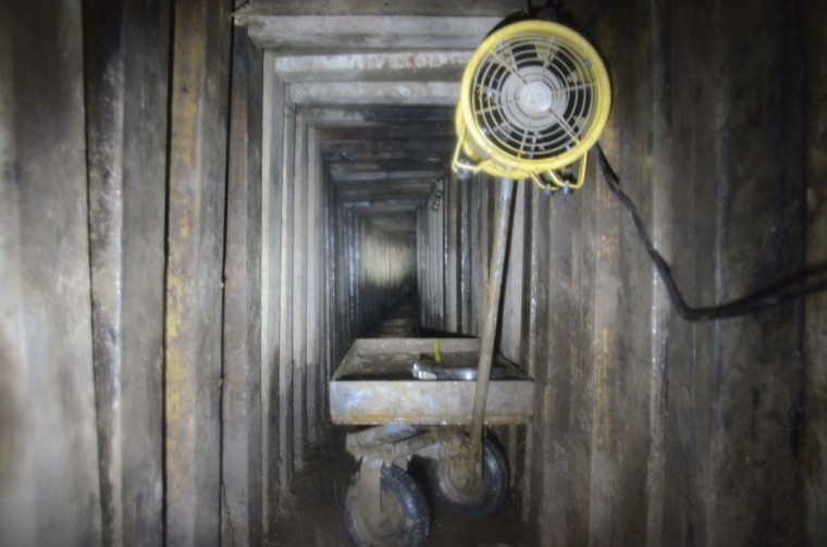 A tunnel, recently discovered by the Municipal Department of Public Safety (DSPM), is seen underground within a cellar in downtown Mexicali city January 5, 2013. The security authorities located the tunnel, measuring 98 feet long and 33 feet deep, which was used for drug trafficking from Mexicali to Calexico, California, in the U.S. after an anonymous tip. The newly discovered tunnel had ventilation and lighting, according to local media. (Stringer/Reuters)