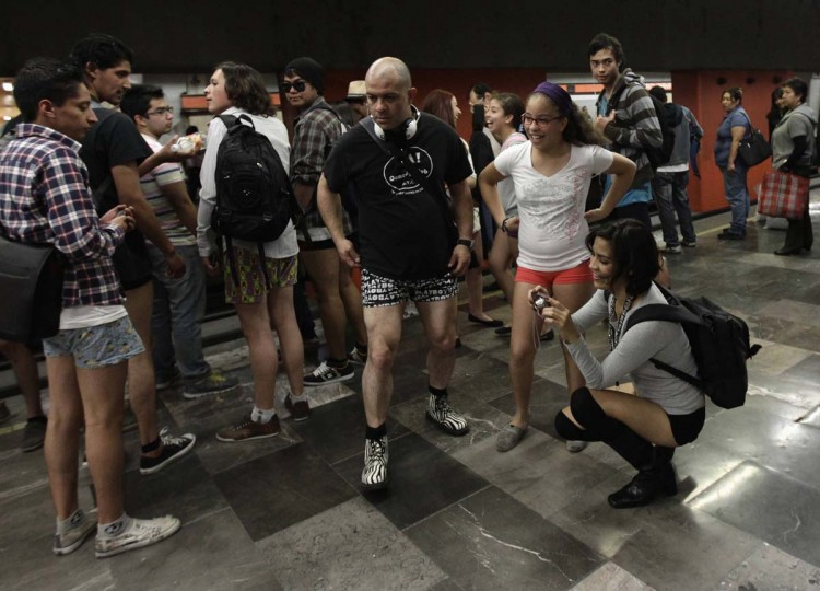 "Participants of ""No Pants Subway Ride""wait for the train in Mexico City January 13, 2013. The event is organized by Flashmob Mexico where participants have to strip down to their underwear as they go about their normal routine, said organizers. (Henry Romero/Reuters)"