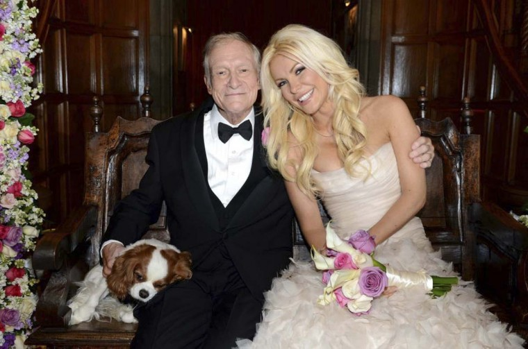 Octogenarian Playboy founder Hugh Hefner poses with his bride Crystal Harris and dog Charlie at their New Year Eve wedding at the Playboy Mansion in Beverly Hills, California in this handout photo taken on December 31, 2012. (Elayne Lodge/PEI/Handout via Reuters)