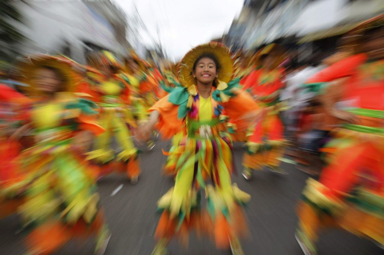 Students perform in a street dance competition during the 15th Sikhyana festival in Santa Rosa city, Laguna province, south of Manila. Locals celebrate the Sikhayan festival, a contraction of Filipino words 'Sikhay' meaning diligence and 'Kabuhayan' for livelihood, to recognize the spirit of enterprise, ingenuity and craftmanship of their people. (Romeo Ranoco/Reuters)