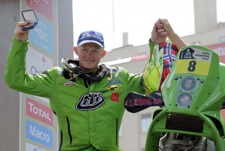 Norway's Pal Ullevalseter celebrates on the podium of the fifth South American edition of the Dakar rally 2013 in Santiago January 20, 2013. (Jacky Naegelen)