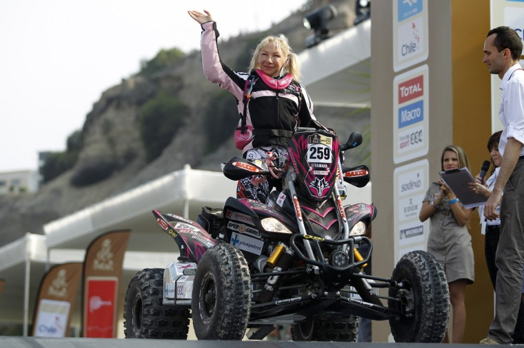 Italy's Camelia Liparoti poses with her Yamaha quad on the podium during the departure ceremony of the fifth South American edition of the Dakar Rally 2013 in Lima January 5, 2013. (Enrique Castro-Mendivil/Reuters)