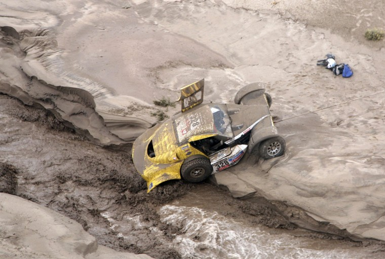 The Buggy MD Rallye of France's Pascal Thomasse and co-pilot Pascal Larroque is stuck in a river following a flash flood during the 11th stage of the Dakar Rally 2013 from La Rioja to Fiambala, January 16, 2013. (Reuters)