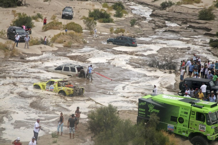 Cars are seen stuck in a river following a flash flood during the 11th stage of the Dakar Rally 2013 from La Rioja to Fiambala January 16, 2013. (Reuters)