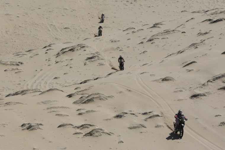 Motorcyclists compete during the 12th stage of the Dakar Rally 2013 from Fiambala to Copiapo, January 17, 2013. (Jacky Naegelen/Reuters)