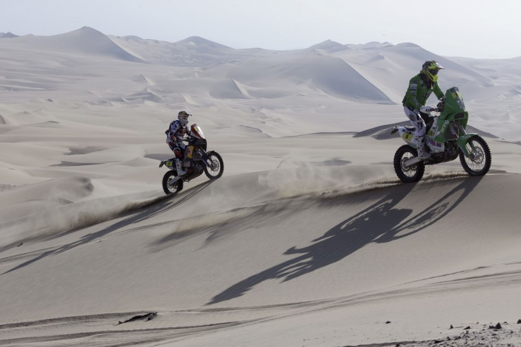 KTM pilots Norway's Pal Ullevalseter (R) and Portugal's Ruben Faria compete in the 3rd stage of the Dakar Rally 2013 from Pisco to Nazca January 7, 2013. (Jacky Naegelen/Reuters)