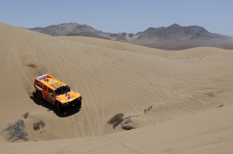 Robby Gordon of the U.S and co-pilot Kellon Walch compete with their Hummer during the 13th stage of the Dakar Rally 2013 from Copiapo to La Serena, January 18, 2013. (Jacky Naegelen/Reuters)