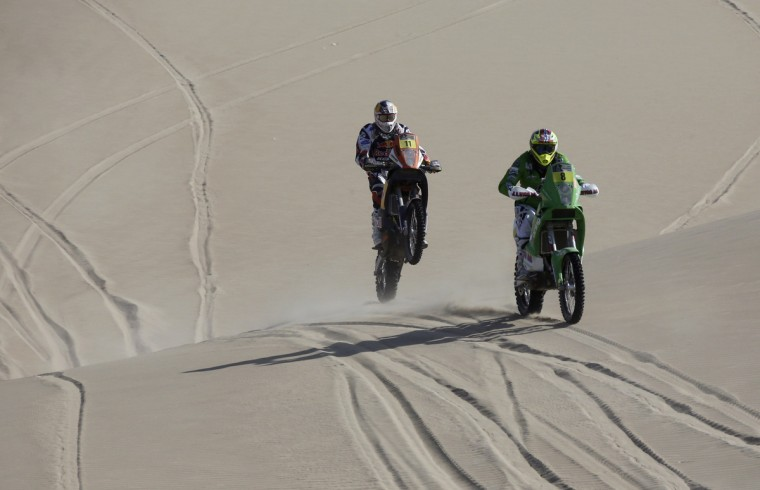 KTM pilots Norway's Pal Ullevalseter (R) and Portugal's Ruben Faria compete during the 3rd stage of the Dakar Rally 2013 from Pisco to Nazca January 7, 2013. (Jacky Naegelen/Reuters)