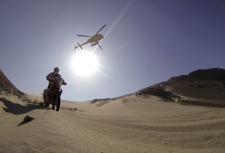 Argentina's Pablo Rodriguez rides his Honda during the 3rd stage of the Dakar Rally 2013 from Pisco to Nazca January 7, 2013. (Jacky Naegelen/Reuters)