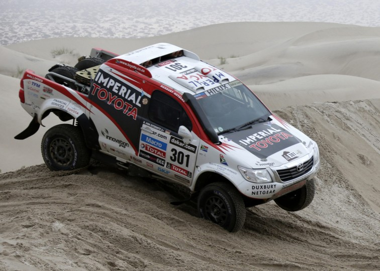 South Africa's Giniel De Villiers and co-pilot Germany's Dirk Von Zitzewitz compete with their Toyota during the 11th stage of the Dakar Rally 2013 from La Rioja to Fiambala, January 16, 2013. (Jacky Naegelen/Reuters)
