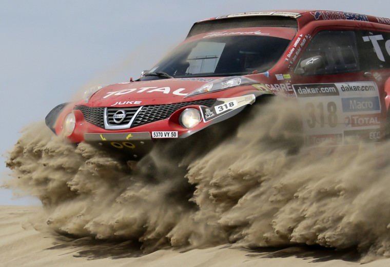 France's Christian Lavieille and co-pilot Jean-Michel Polato compete with their Proto Dessoude during the first stage of the Dakar Rally 2013 from Lima to Pisco January 5, 2013.