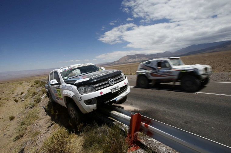 A support vehicle crashes on a road barrier at the highlands of Chile en route to the Jama border crossing during the untimed 7th stage of the Dakar Rally 2013 from Calama to Salta, January 11, 2013. (Ivan Alvarado/Reuters)