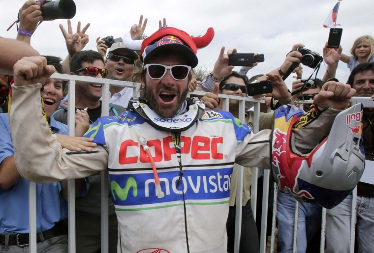 Chile's Francisco Chaleco Lopez Contardo celebrates as he took the third place after the 14th and last stage of the Dakar Rally 2013 from La Serena to Santiago, January 19, 2013. (Jacky Naegelen/Reuters)